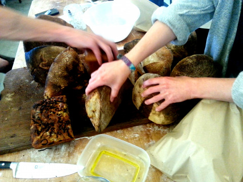 Volunteers sharing bread. Photo: Ingrid