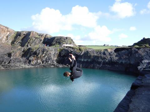 Volunteer doing a backflip off a high cliff into the sea! Photo: Costas, 2017